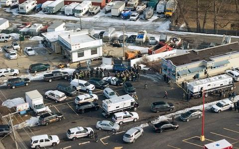 First responders and emergency vehicles are gathered near the scene of a shooting at an industrial park in Aurora - Credit: Bev Horne/Daily Herald