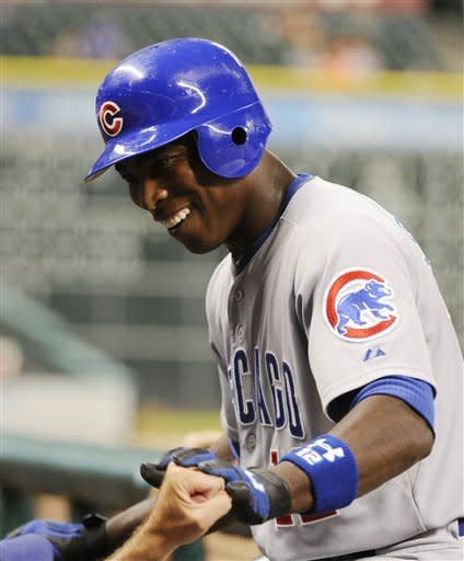 Chicago Cubs' Alfonso Soriano heads into the dugout after hitting a solo home run against the Houston Astros in the fifth inning of a baseball game Wednesday, Sept. 12, 2012, in Houston. (AP Photo/Pat Sullivan)