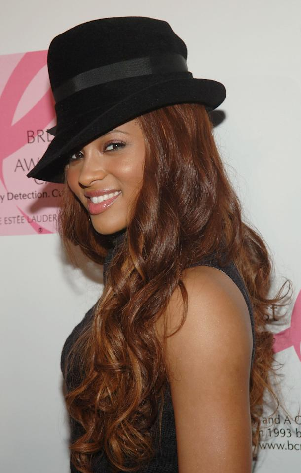 <p>Ciara topped off her gorgeous auburn hair with a fedora for her appearance at an event for Estée Lauder.</p>