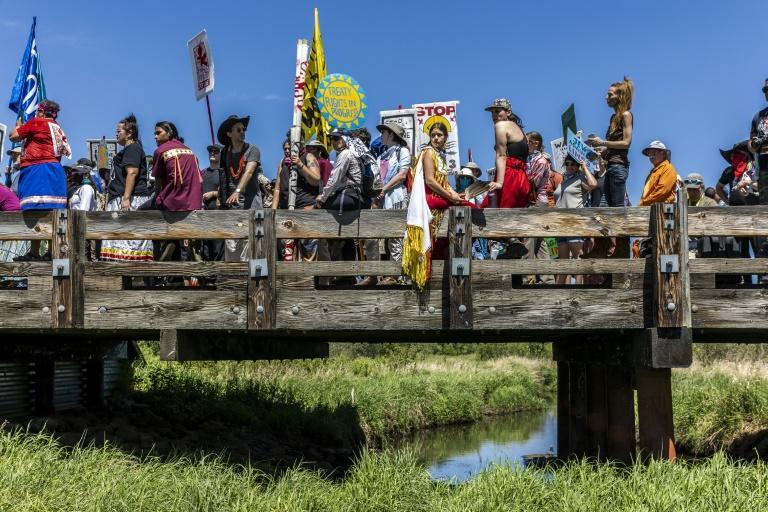 Climate activist and indigenous community members are seen after taking part in a traditional water ceremony during a protest against the Line 3 pipeline on June 7, 2021