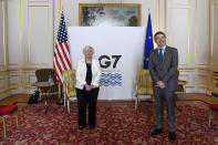 U.S. Treasury Secretary Janet Yellen, left, and Eurogroup President Paschal Donohoe pose for photos as finance ministers from across the G7 nations meet at Lancaster House in London, Saturday, June 5, 2021, ahead of the G7 leaders' summit. (AP Photo/Alberto Pezzali, Pool)