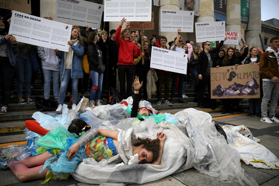 Young activists stage a performance during an environmental demonstration, part of the Global Climate Strike, in Warsaw, Poland September 20, 2019. (Photo: Maciek Jazwiecki/Agencja Gazeta via Reuters)