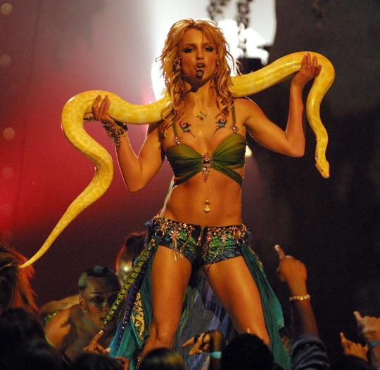 "<p>Spears performed her hit ""I'm A Slave 4 U"" at the 2001 MTV Music Awards, complete with beach waves and a snake. (Photo: Getty Images)</p>"