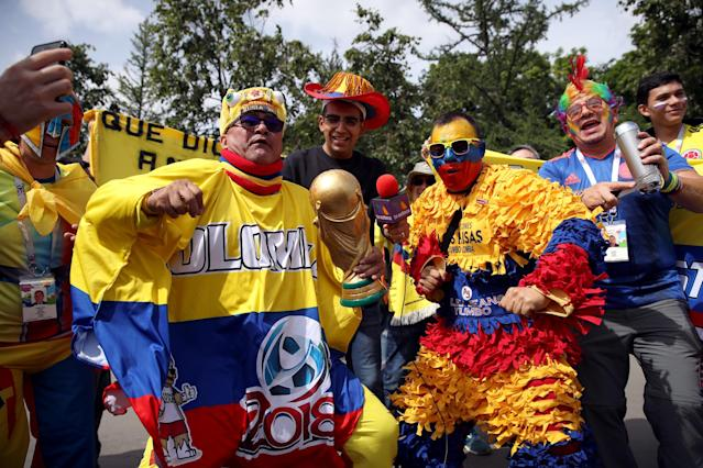 <p>Colombia fans get in on the carnival atmosphere with a replica world cup trophy. (PA) </p>