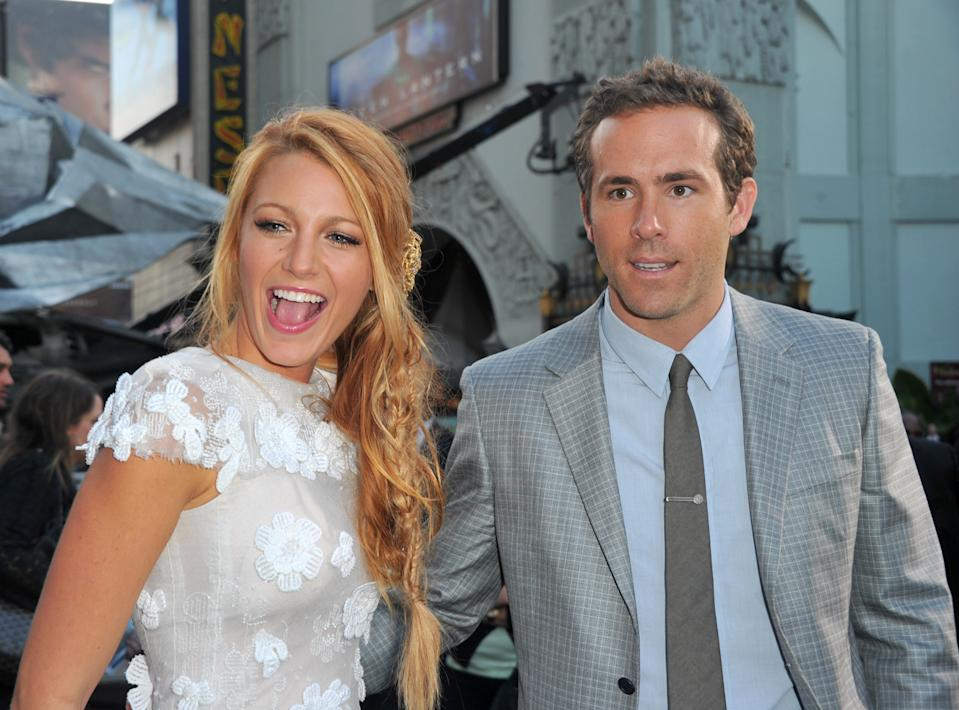 """HOLLYWOOD, CA - JUNE 15:  Actors Blake Lively (L) and Ryan Reynolds arrive at the premiere of Warner Bros. Pictures' """"Green Lantern"""" held at Grauman's Chinese Theatre on June 15, 2011 in Hollywood, California.  (Photo by Alberto E. Rodriguez/Getty Images)"""