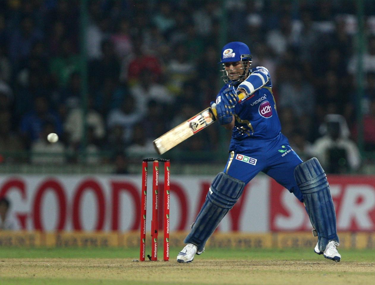MI batsman Sachin Tendulkar in action during the 2nd CLT20 semi-final match between Mumbai Indians and Trinidad & Tobago at Feroz Shah Kotla, Delhi on Oct. 5, 2013. (Photo: IANS)