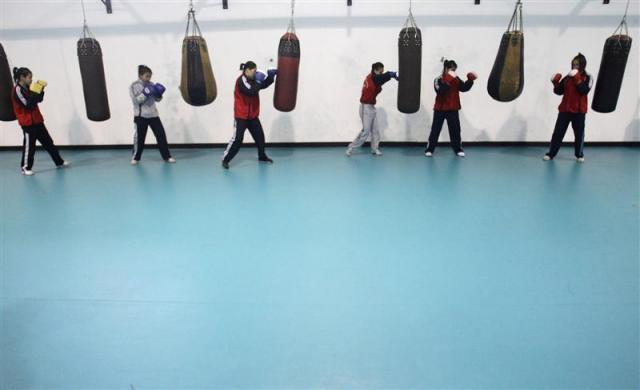 Members of the Vietnam female boxing team practice at a training center in Hanoi February 17, 2012.
