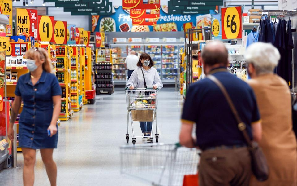 Customers move through a Morrisons supermarket, operated by Wm Morrison Supermarkets Plc - Chris Ratcliffe/Bloomberg