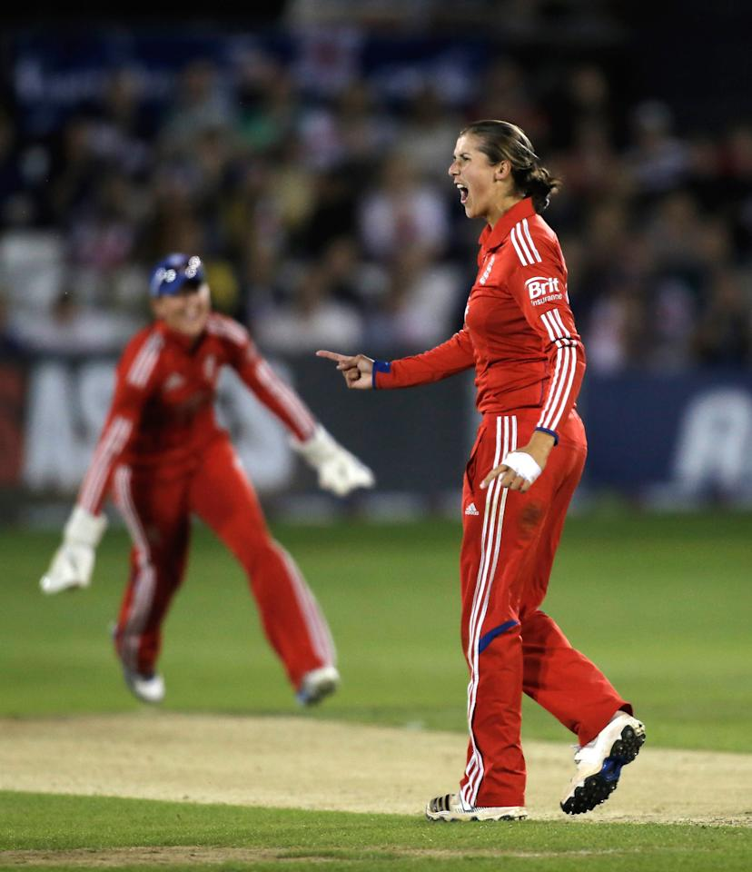 CHELMSFORD, ENGLAND - AUGUST 27:  Jenny Gunn of England celebrates bowling Jodie Fields of Australia (not pictured) during the first NatWest T20 match between England and Australia at the Ford County Ground on August 27, 2013 in Chelmsford, England.  (Photo by Harry Engels/Getty Images)