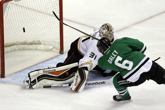 Dallas Stars defenseman Trevor Daley (6) scores a goal against Anaheim Ducks goalie Frederik Andersen (31) during the first period of Game 6 of a first-round NHL hockey playoff series in Dallas, Sunday, April 27, 2014. (AP Photo/LM Otero)