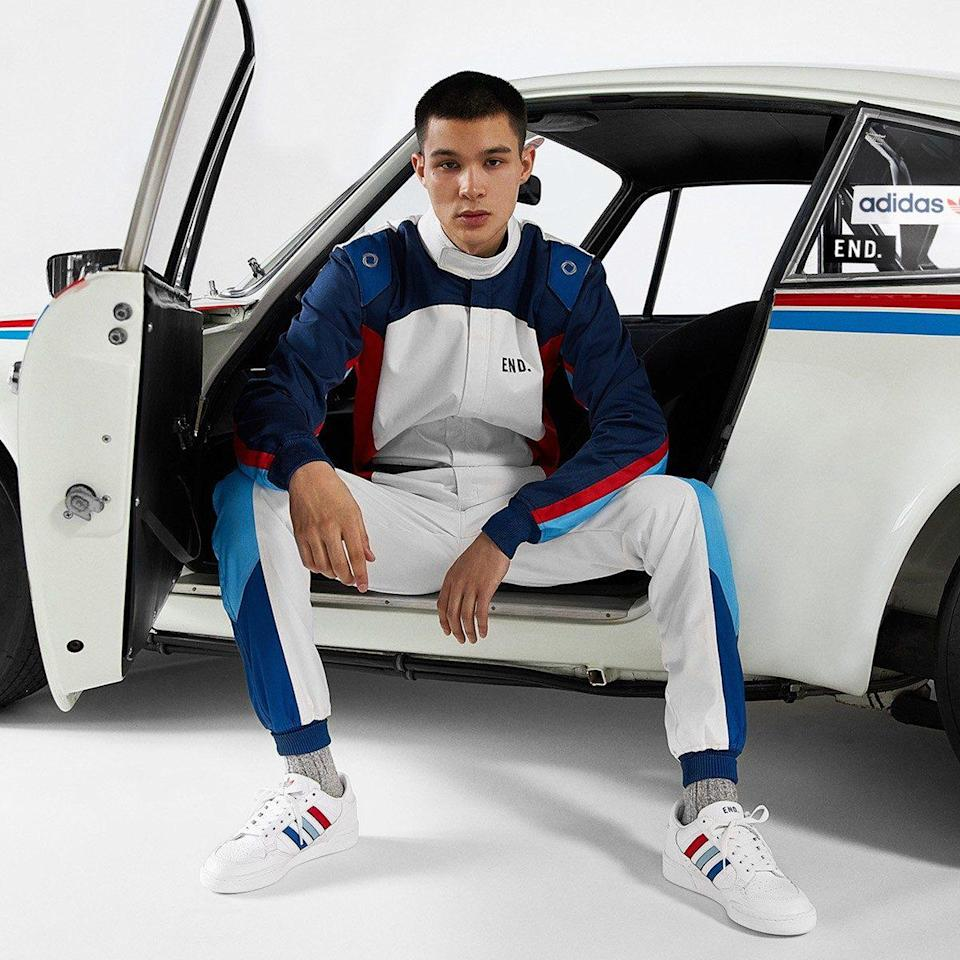 model wearing Adidas trainers sitting in car