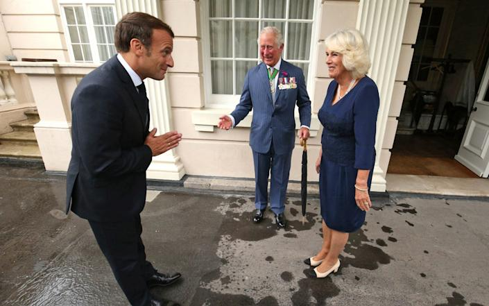 Prince Charles, Prince of Wales and Camilla, Duchess of Cornwall greet French President Emmanuel Macron with a namaste gesture - presumably to ensure social distancing - Getty Images Europe/WPA Pool