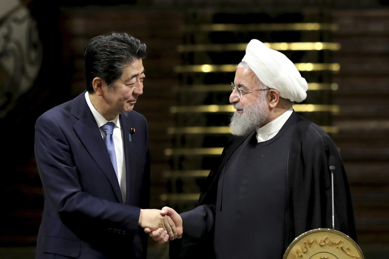 Japanese Prime Minister Shinzo Abe and Iranian President Hassan Rouhani after a joint press conference in Tehran on June 12. (Photo: Ebrahim Noroozi/AP)