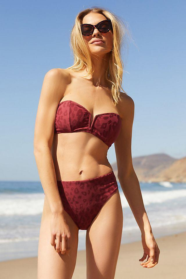"""<p><strong>PQ Swim</strong></p><p>anthropologie.com</p><p><strong>$84.00</strong></p><p><a href=""""https://go.redirectingat.com?id=74968X1596630&url=https%3A%2F%2Fwww.anthropologie.com%2Fshop%2Fpq-chrissy-bikini-top&sref=https%3A%2F%2Fwww.oprahdaily.com%2Fstyle%2Fg36166852%2Fbest-swimsuits-for-small-busts%2F"""" rel=""""nofollow noopener"""" target=""""_blank"""" data-ylk=""""slk:SHOP NOW"""" class=""""link rapid-noclick-resp"""">SHOP NOW</a></p><p>A notched bandeau with front seaming works to define the bust area—and we love the tonal leopard print.</p>"""
