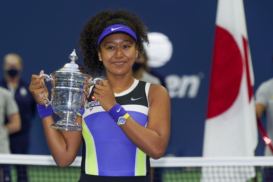 FILE - Naomi Osaka, of Japan, holds up the championship trophy after defeating Victoria Azarenka, of Belarus, in the women's singles final of the U.S. Open tennis championships in New York, in this Saturday, Sept. 12, 2020, file photo. Three-Time Grand Slam singles champion Naomi Osaka has invested in the North Carolina Courage of the National Women's Soccer League, citing the importance of supporting women as role models and leaders. (AP Photo/Seth Wenig, File)