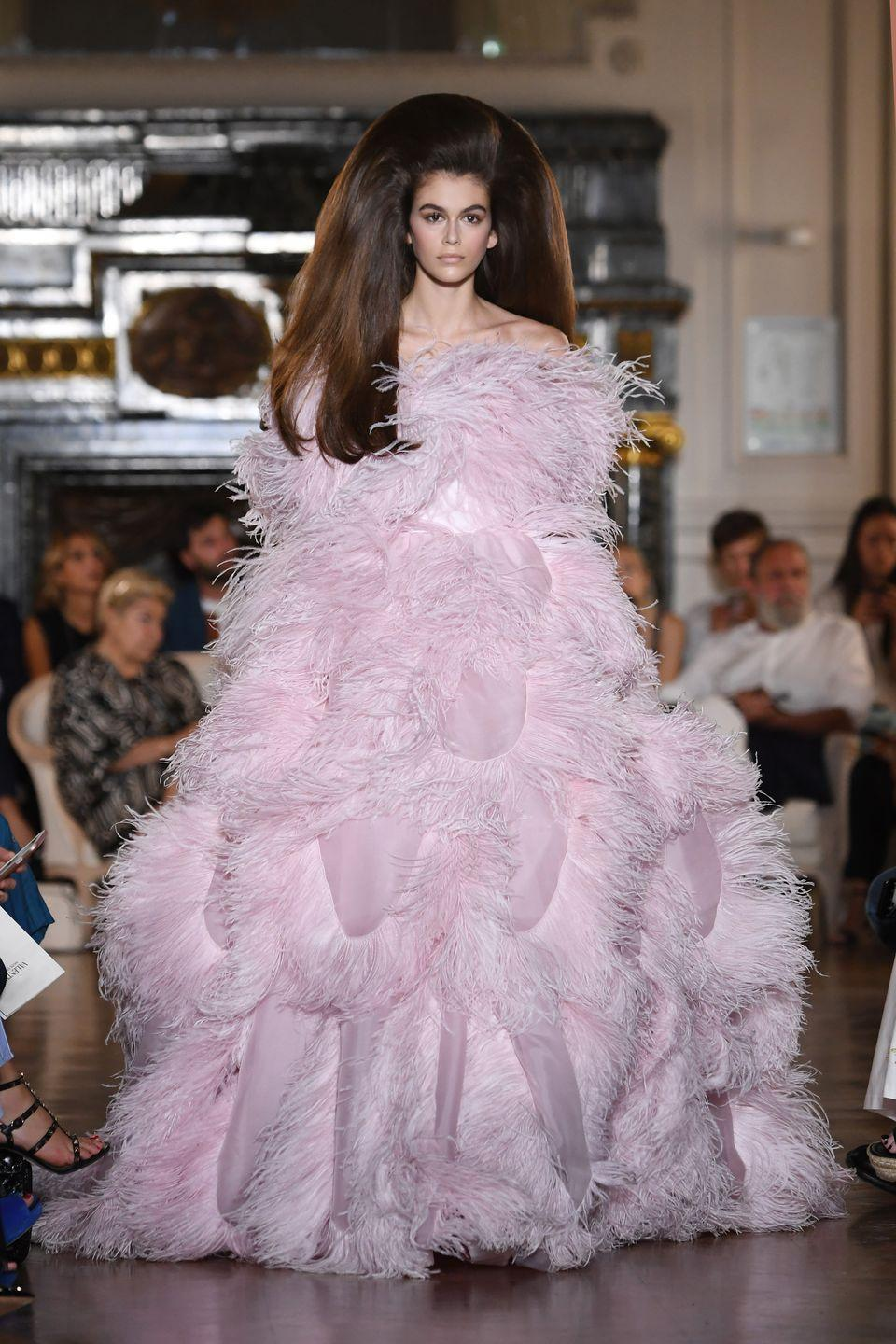 <p>The teenager looked stunning in a feathered pink gown at the Valentino fashion show during Haute Couture AW18/19 in Paris, July 2018</p>