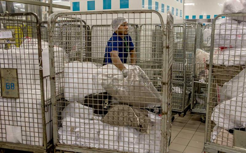 All blankets and items like mattresses used during flights are also washed in an area of the facility. | Talia Avakian