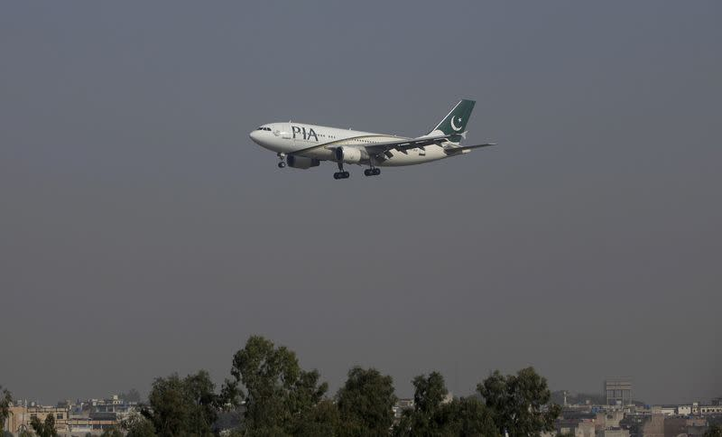 FILE PHOTO: A Pakistan International Airlines (PIA) passenger plane arrives at the Benazir International airport in Islamabad, Pakistan