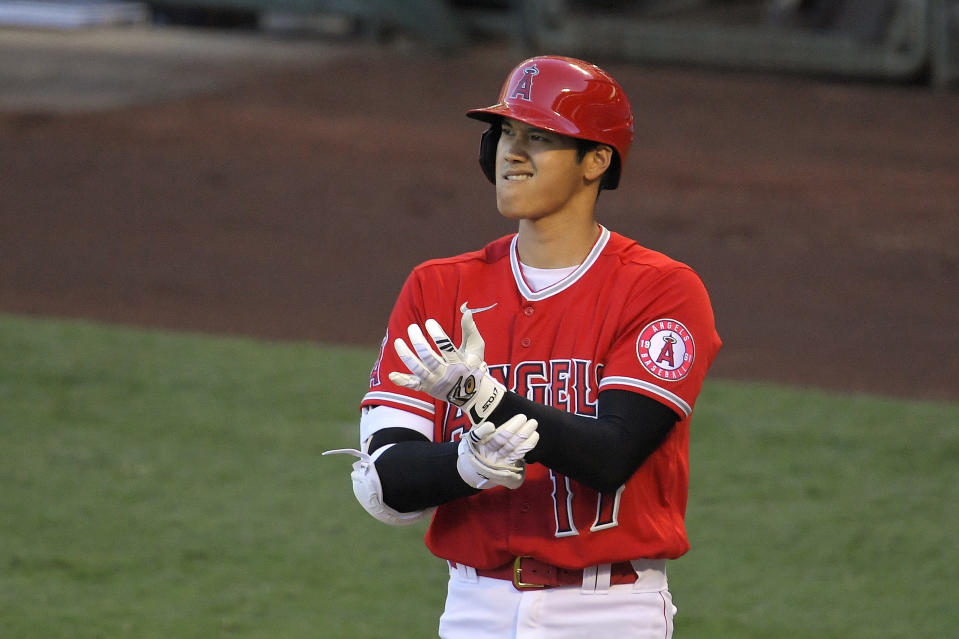 Los Angeles Angels' Shohei Ohtani adjusts his gloves during an at-bat din the first inning of a baseball game against the Houston Astros Friday, July 31, 2020, in Anaheim, Calif. (AP Photo/Mark J. Terrill)