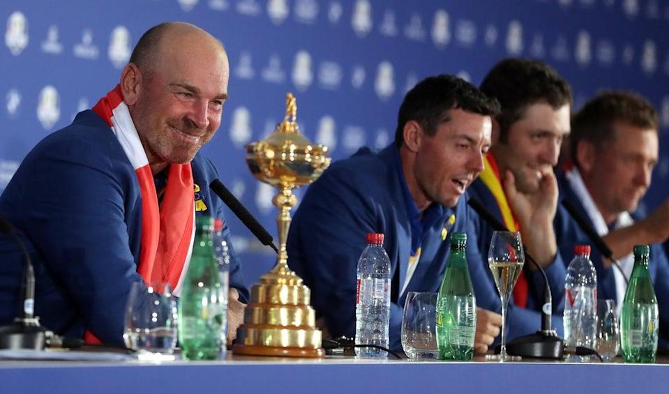 Captain Thomas Bjorn (left) and Rory McIlroy (centre) in a press conference after Europe's Ryder Cup win in Paris (David Davies/PA) (PA Archive)