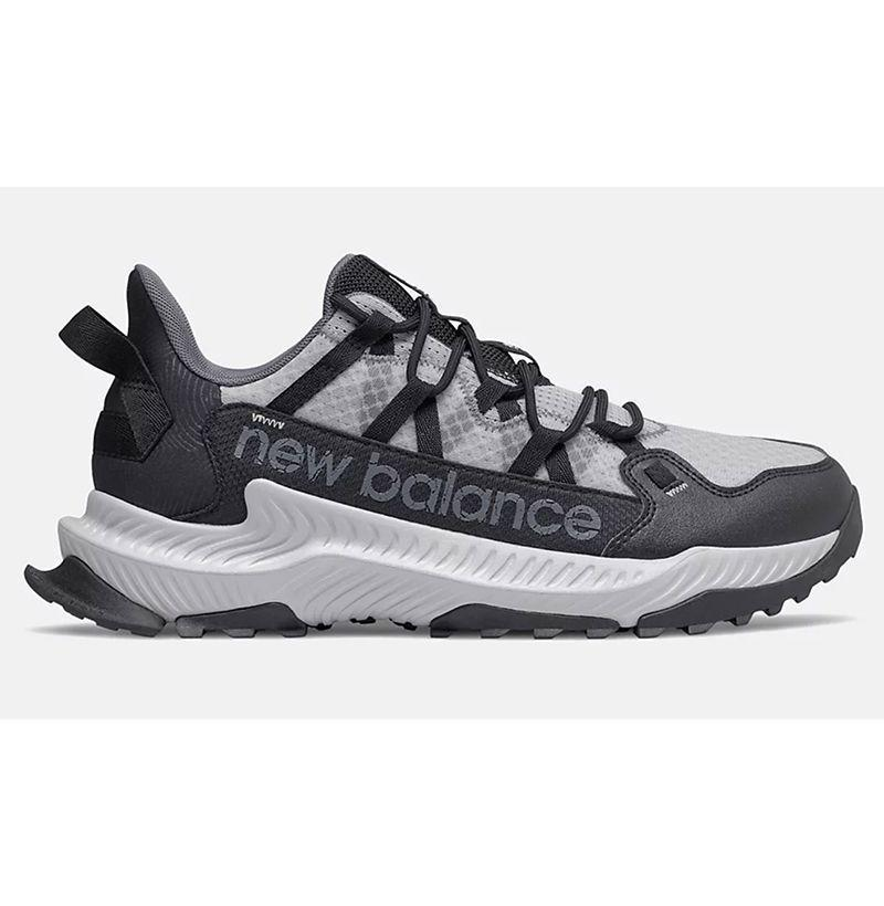 """<p><strong>New Balance</strong></p><p>newbalance.com</p><p><strong>$89.99</strong></p><p><a href=""""https://go.redirectingat.com?id=74968X1596630&url=https%3A%2F%2Fwww.newbalance.com%2Fpd%2Fshando%2FMTSHAV1-31077.html&sref=https%3A%2F%2Fwww.esquire.com%2Fstyle%2Fmens-fashion%2Fg29339512%2Fbest-winter-sneakers%2F"""" rel=""""nofollow noopener"""" target=""""_blank"""" data-ylk=""""slk:Buy"""" class=""""link rapid-noclick-resp"""">Buy</a></p><p>New Balance's updated take on the classic hiking shoe might not offer the same sort of winter weather detailing as some of its counterparts included here, but the style's treaded soles and added traction make it ideal if you're looking for an all-season shoe that can seamlessly transition to tackling the worst of the outdoors on a whim. </p>"""