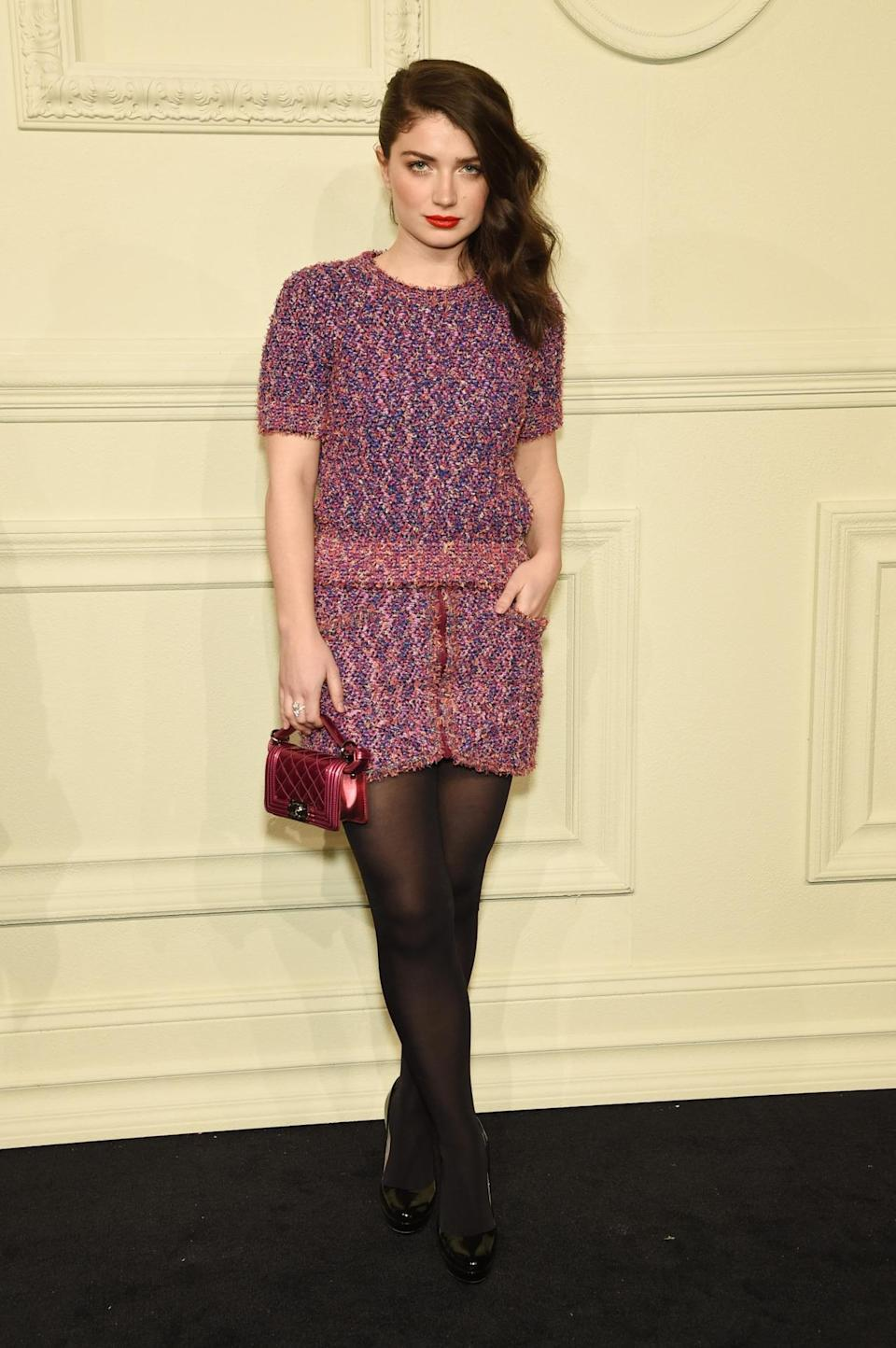 <p>Actress Eve Hewson (who also happens to be Bono's daughter) is all business in a pink tweed dress with a matching metallic bag.</p>