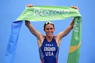 <p>Gwen Jorgensen of the United States celebrates as she wins gold during the Women's Triathlon on Day 15 of the Rio 2016 Olympic Games at Fort Copacabana on August 20, 2016 in Rio de Janeiro, Brazil. (Photo by Matthias Hangst/Getty Images) </p>