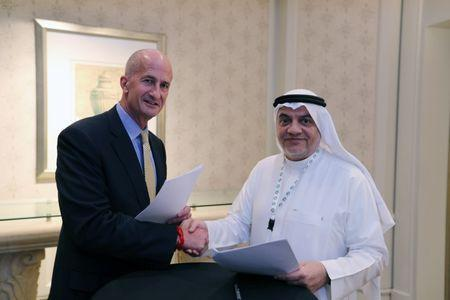 Vice Chairman of General Electric, John Rice and Saudi Governor of Small & Medium Enterprises, Ghassan Ahmed Al Sulaiman pose for photos after signing their agreements at the Saudi-US CEO Forum 2017 ahead of the arrival of the U.S. President Donald Trump, in Riyadh, Saudi Arabia May 20, 2017. REUTERS/Hamad I Mohammed