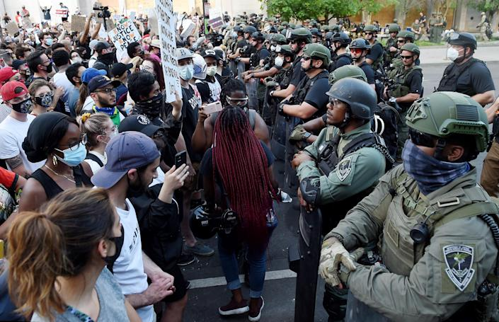 Police face and demonstrators face off near the White House during a protest over the death of George Floyd,in Washington, DC, on June 3, 2020. - Former Minneapolis police officer Derek Chauvin, who kneeled on the neck of George Floyd who later died, will now be charged with second-degree murder, and his three colleagues will face charges of aiding and abetting second-degree murder, court documents revealed on June 3. (Photo by Olivier DOULIERY / AFP) (Photo by OLIVIER DOULIERY/AFP via Getty Images)
