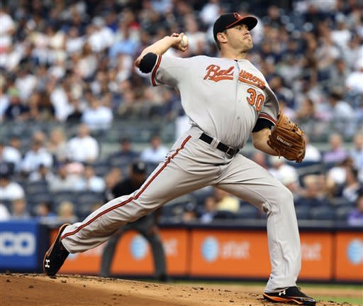 Baltimore Orioles' Chris Tillman pitches during the first inning of a baseball game against the New York Yankees, Tuesday, July 31, 2012, at Yankee Stadium in New York. (AP Photo/Seth Wenig)