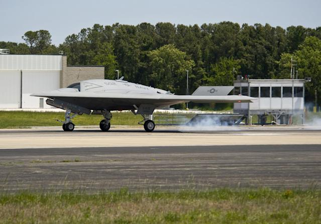 NAVAL AIR STATION PATUXENT RIVER, MD - MAY 14: In this handout released by the U.S. Navy courtesy of Northrop Grumman, the X-47B Unmanned Combat Air System (UCAS) demonstrator lands after completing the first launch of an unmanned aerial vehicle from an aircraft carrier May 14, 2013 at Naval Air Staion Patuxent River, Maryland. George H.W. Bush is the first aircraft carrier to successfully catapult-launch an unmanned aircraft from its flight deck. The Navy plans to have unmanned aircraft on each of its carriers to be used for surveillance and be armed and used in combat roles. (Photo by U.S. Navy/Northrop Grumman via Getty Images)