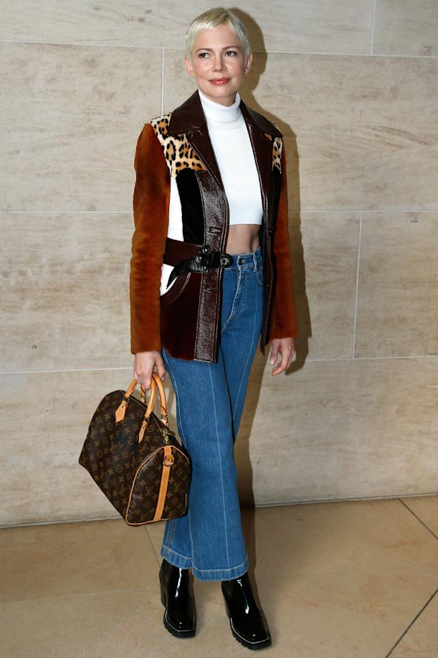 <p><strong>3 October</strong> Michelle Williams sat on the front row for the Louis Vuitton catwalk show wearing a brow, white, black and leopard print jacket with a crop top and jeans. </p>