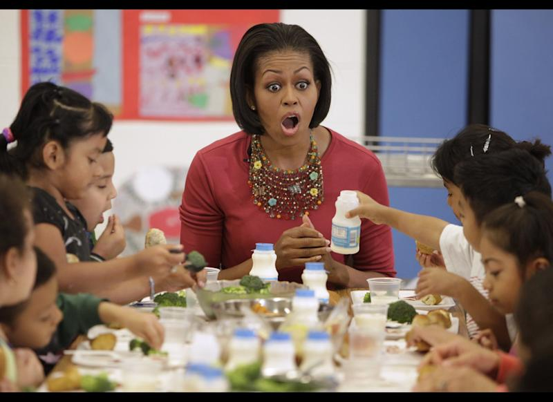 US First Lady Michelle Obama joins children during their lunch at New Hampshire Elementary School in Silver Spring, Maryland on May 19, 2010. AFP PHOTO/YURI GRIPAS (Photo credit should read YURI GRIPAS/AFP/Getty Images)