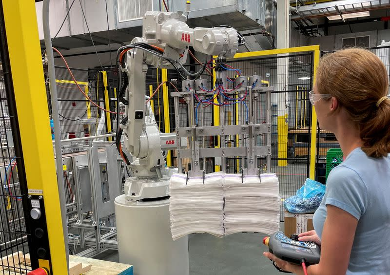 FILE PHOTO: A researcher works on a new robot for handling sheets in Cincinnati