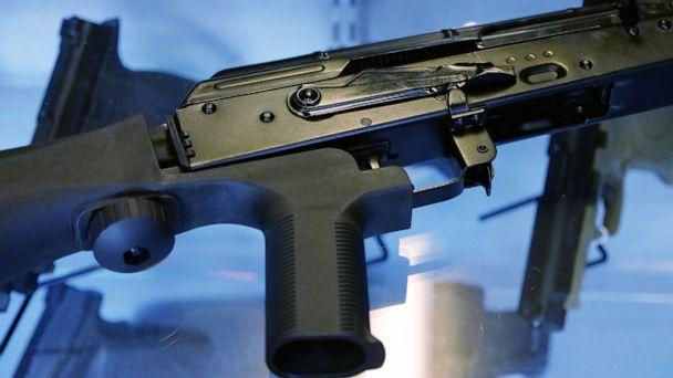 PHOTO: In this Oct. 4, 2017, file photo, a device called a 'bump stock' is attached to a semi-automatic rifle at the Gun Vault store and shooting range in South Jordan, Utah. (Rick Bowmer/AP, File)
