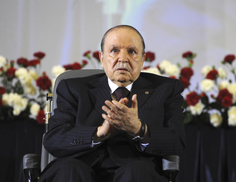 FILE - In this April 28, 2014, file photo, Algerian President Abdelaziz Bouteflika, sitting in a wheelchair, applauds after taking the oath as President in Algiers. Former Algerian President Bouteflika, who fought for independence from France in the 1950s and 1960s and was ousted amid pro-democracy protests in 2019 after 20 years in power, has died at age 84, state television announced Friday, Sept. 17, 2021. (AP Photo/Sidali Djarboub, File)