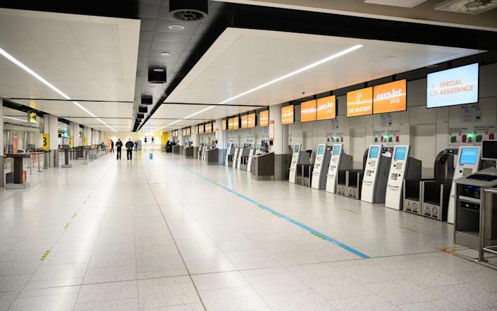 Rows of empty EastJet check-in desks in the North Terminal at Gatwick Airport in November 2020 - Leon Neal/Getty Images
