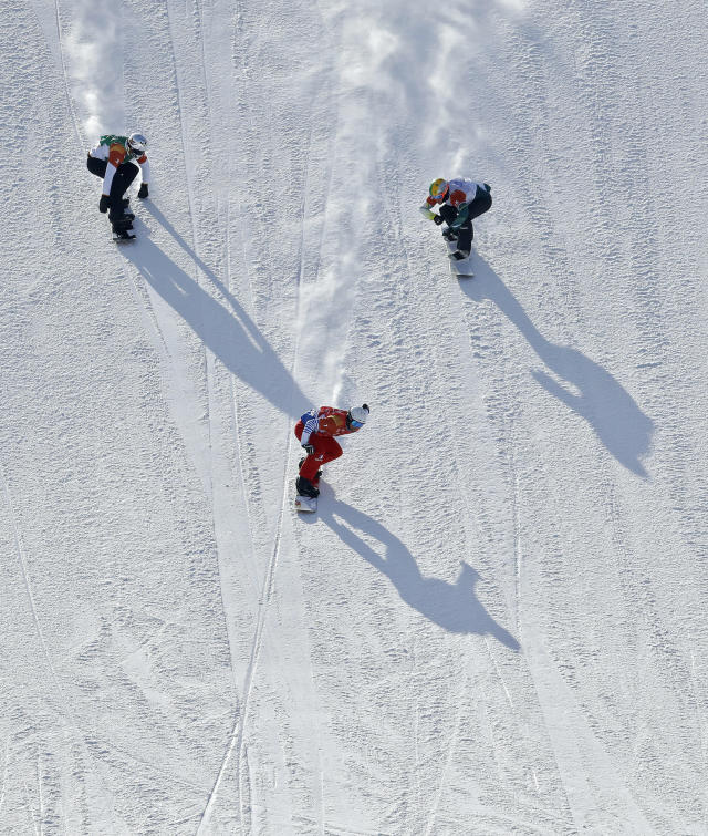 <p>Bronze medal winner Regino Hernandez, of Spain, left, silver medal winner Jarryd Hughes, of Australia, right, and gold medal winner Pierre Vaultier, of France, run the course during the men's snowboard cross final at Phoenix Snow Park at the 2018 Winter Olympics in Pyeongchang, South Korea, Thursday, Feb. 15, 2018. (AP Photo/Lee Jin-man) </p>
