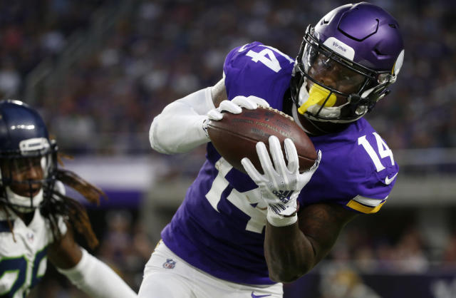 Minnesota Vikings wide receiver Stefon Diggs (14) catches a pass during the first half of an NFL preseason football game against the Seattle Seahawks, Friday, Aug. 24, 2018, in Minneapolis. (AP Photo/Bruce Kluckhohn)