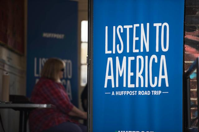 A Listen to America sign sits outside a video station.