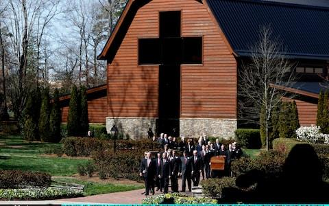 The casket carrying the body of Rev Billy Graham is carried to his funeral service at the Billy Graham Library - Credit: Getty Images