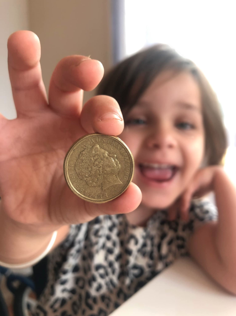 Smiing child with mule dollar.