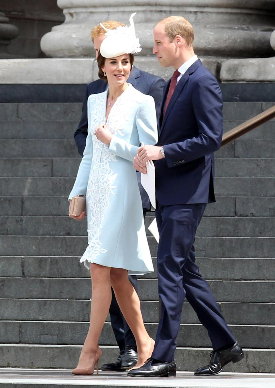 <p>The Duchess of Cambridge wore a bespoke Catherine Walker coat dress. The pastel blue coat featured intricate white embroidery. <i><i>(Photo: Rex Features)</i></i><br></p>
