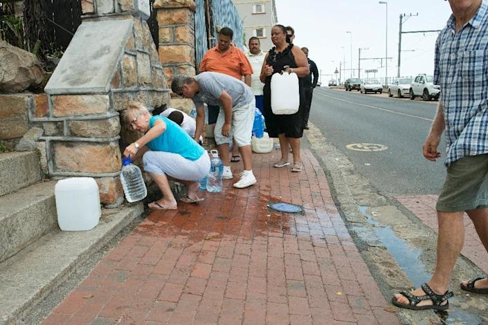 Drought-hit Cape Town earlier this year came within weeks of shutting off all its taps and forcing residents to queue for water rations at public standpipes (AFP Photo/RODGER BOSCH)