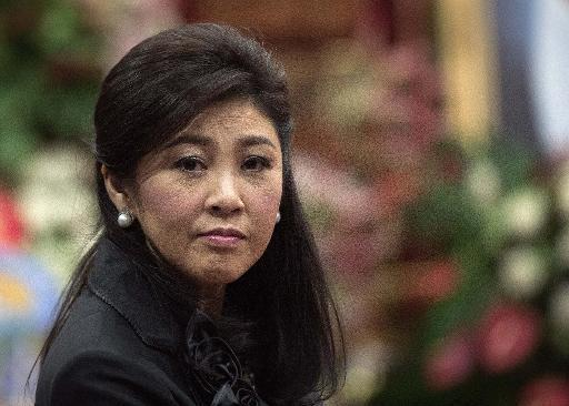 Thai former PM Yingluck to face trial over rice scheme