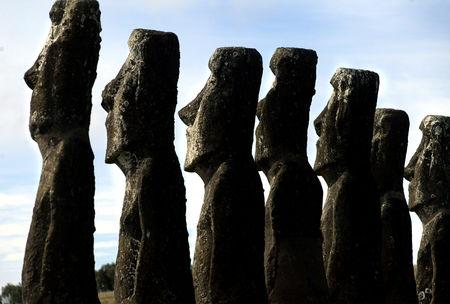 "FILE PHOTO: A view of ""Moai"" statues in Ahu Akivi, on Easter Island, 4,000 km (2,486 miles) west of Santiago, in this photo taken Oct. 31, 2003. Easter Island's mysterious ""Moai"", giant head statues carved out of volcanic rock, are in danger of being destroyed by years of tropical rains and wind as well as careless humans and farms animals. Experts have called on the international community to commit funds to preserve the monoliths, whose mystery draws tourists to the world's most remote inhabited island. REUTERS/Carlos Barria"