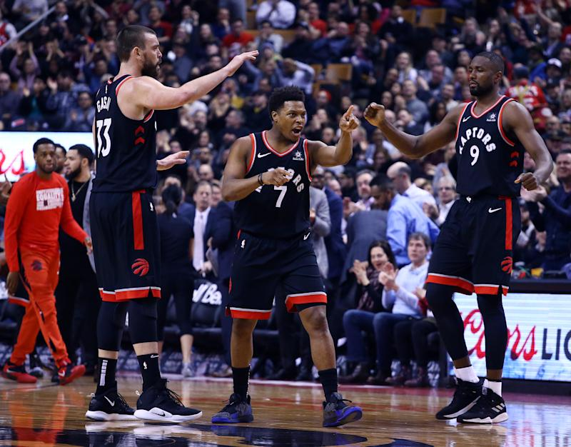 TORONTO, ON - FEBRUARY 11: Marc Gasol #33 and Serge Ibaka #9 of the Toronto Raptors congratulate Kyle Lowry #7 during the first half of an NBA game against the Brooklyn Nets at Scotiabank Arena on February 11, 2019 in Toronto, Canada. NOTE TO USER: User expressly acknowledges and agrees that, by downloading and or using this photograph, User is consenting to the terms and conditions of the Getty Images License Agreement. (Photo by Vaughn Ridley/Getty Images)