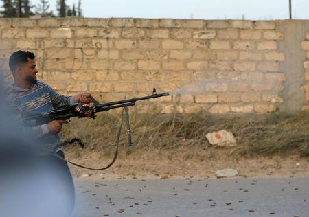 Member of the Libyan internationally recognised government forces fires during fighting with Eastern forces in Ain Zara