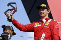 Ferrari driver Charles Leclerc of Monaco stands on the podium after finishing second in the British Formula One Grand Prix, at the Silverstone circuit, in Silverstone, England, Sunday, July 18, 2021. (Lars Baron/Pool photo via AP)