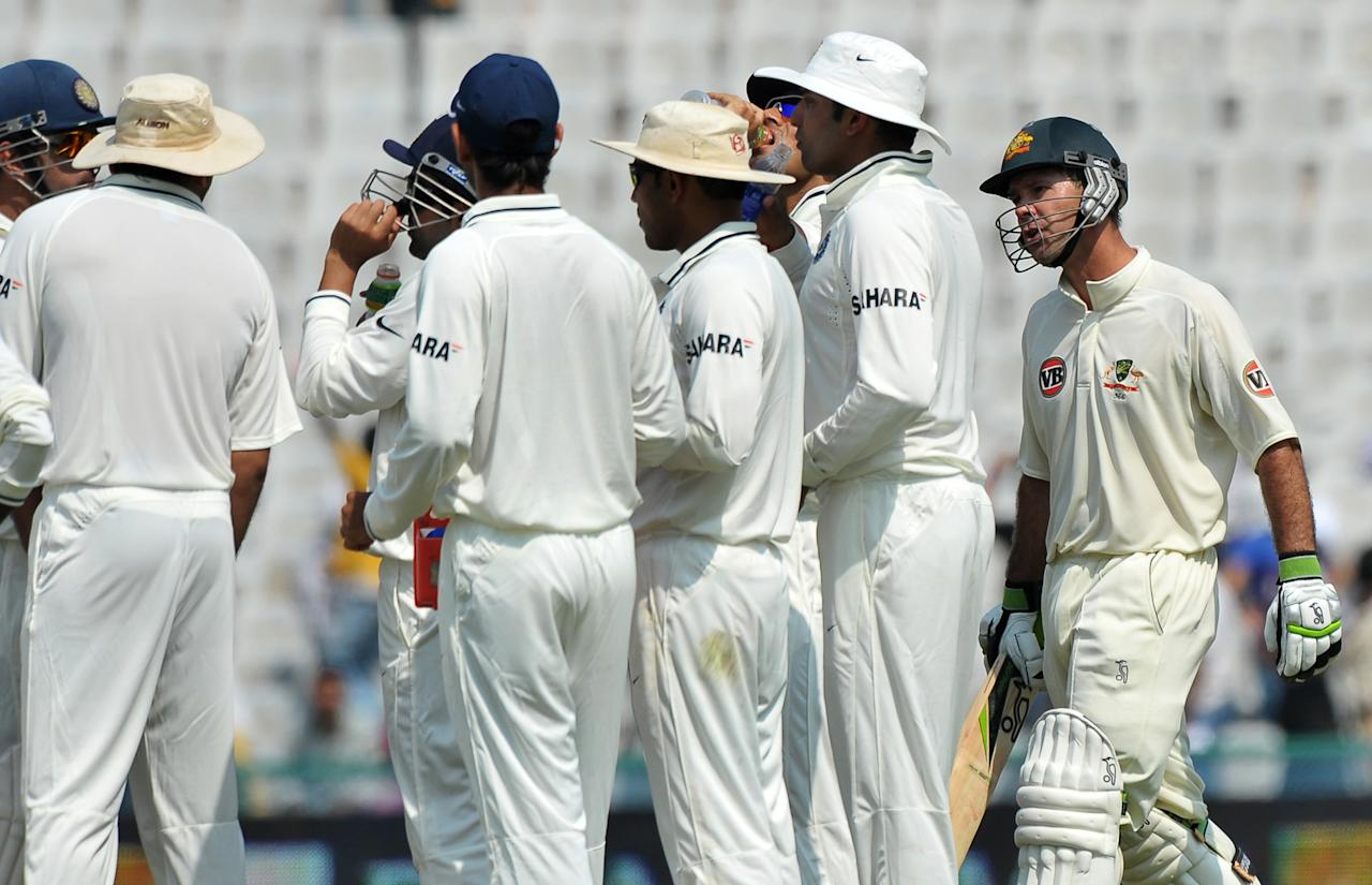 Australian cricket captain Ricky Ponting (R) reacts as he turns back to talk to the Indian cricketers on his way to the dressing room after losing his wicket on the first day of the first Test match between India and Australia in Mohali on October 1, 2010.  Australia are 156 runs for the loss of two wickets in 45 overs after captain Ricky Ponting won the toss and elected to bat first.   AFP PHOTO/Dibyangshu SARKAR (Photo credit should read DIBYANGSHU SARKAR/AFP/Getty Images)